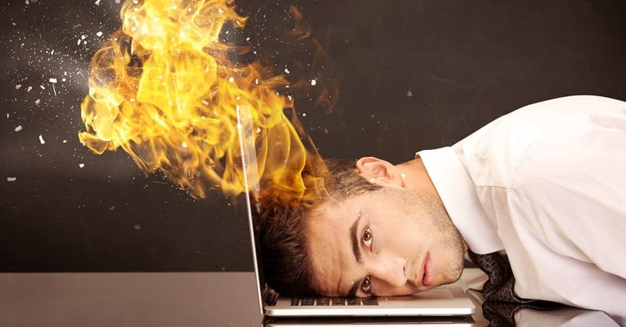 Stressed business man's head is burning